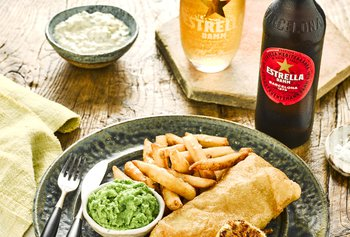 Estrella Damm Beer Battered Fish and Chips With Glass And Bottle.jpg